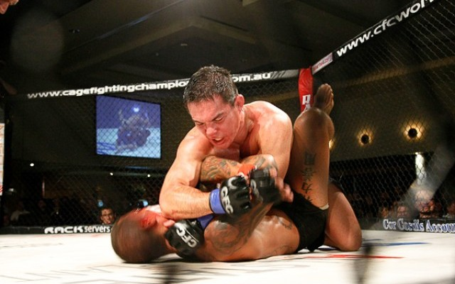 Adrian Pang (top) delivers an elbow (Scott Clark/Sherdog)