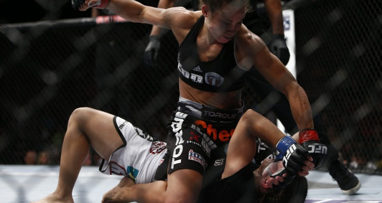 Carmouche (top) delivers punishment (Esther Lin/MMA Fighting)