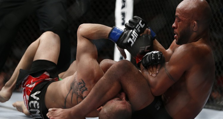 Demetrious Johnson (R) sets up an armbar (Esther Lin/MMA Fighting)