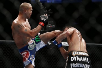 Robbie Lawler (L) connects with a head kick (Esther Lin/MMA Fighting)