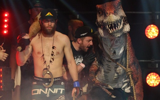 David Rickels walks to the cage with his pet dinosaur (Keith Mills/Sherdog)