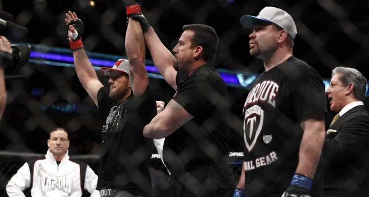 Ryan Bader (L) celebrates victory (Esther Lin/MMA Fighting)
