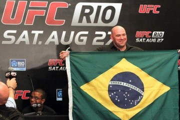 UFC President Dana White holds up a Brazilian flag (Sherdog)