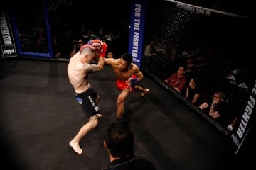Suasday Chau (R) delivers a punch (Facebook)