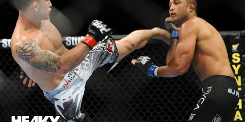Frankie Edgar (L) throws a kick against B.J. Penn (Heavy MMA)
