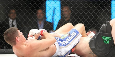 Charles Rosa (L) secures an armbar (Keith Mills/Sherdog)