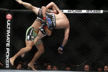 Brendan Schaub (L) scores a takedown (Esther Lin/MMA Fighting)