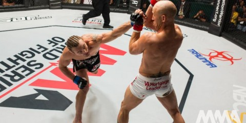 Steve Carl (L) delivers a left hand against Josh Burkman (World Series of Fighting)