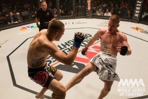 Justin Gaethje (R) connects with a leg kick (World Series of Fighting)