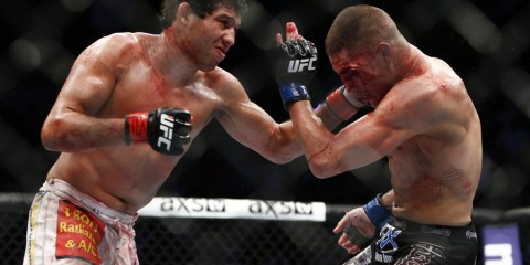 Gilbert Melendez (L) battles Diego Sanchez (Esther Lin/MMA Fighting)