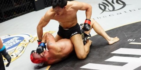 Eddie Ng (top) batters his opponent (ONE FC)