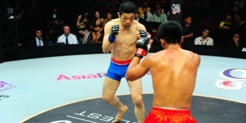 Koji Oishi (blue trunks) battles Honorio Banario (ONE FC)