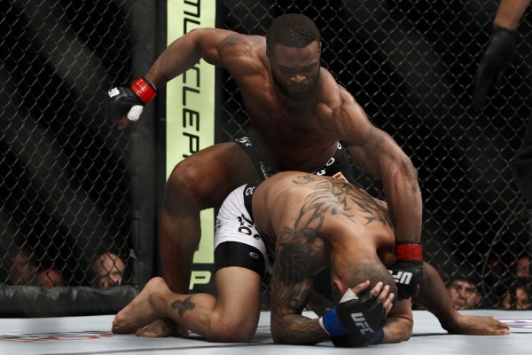 Woodley (top) looks to finish (Esther Lin/MMA Fighting)