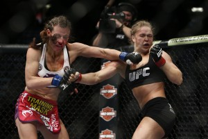 Miesha Tate (L) and Ronda Rousey battle at UFC 168 (Esther Lin/MMA Fighting)