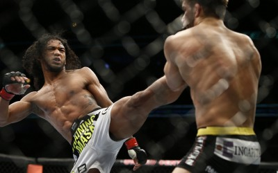 Benson Henderson (L) throws a head kick (Esther Lin/MMA Fighting)