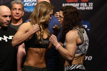 Ronda Rousey (L) faces off with Sara McMann (Dave Mandel/Sherdog)