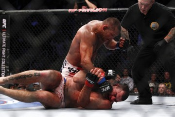 "Dan Henderson (top) battles Mauricio ""Shogun"" Rua (Esther Lin/MMA Fighting)"
