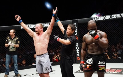 Brock Larson (L) has his arm raised in victory (ONE FC)