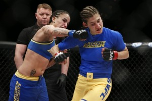 Pennington (L) connects with a punch (Esther Lin/MMA Fighting)