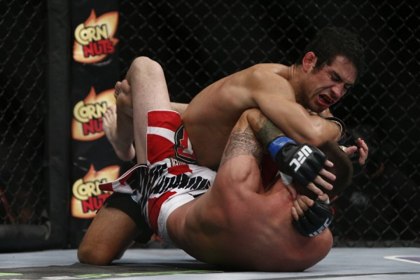 Danny Castillo (top) (Esther Lin/MMA Fighting)