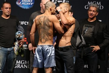 Renan Barao (L) squares off with T.J. Dillashaw (Dave Mandel/Sherdog)