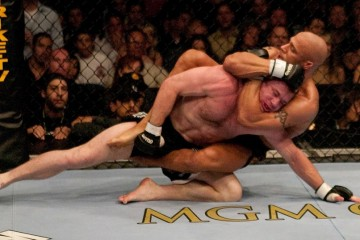 Trigg looks to sink in a rear naked choke against Hughes during their thrilling title fight at UFC 52 (Josh Hedges/Zuffa LLC)