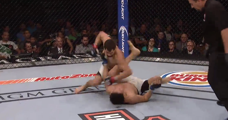 Jorge Masvidal (top) finished Cezar Ferreira (bottom) with strikes (UFC on FOX)