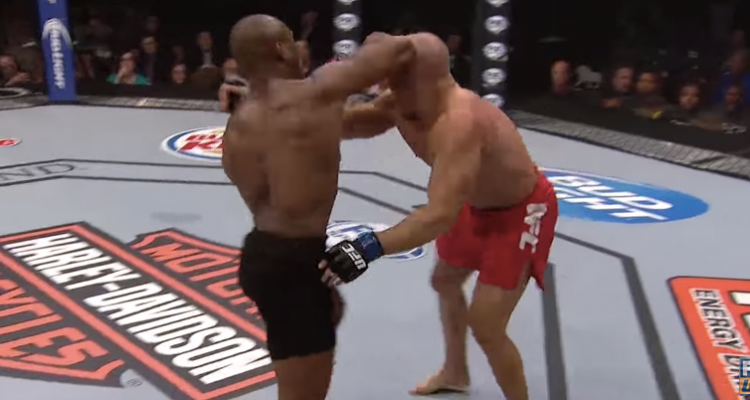 Kamaru Usman (L) lands a standing elbow on Hayder Hassan (R)